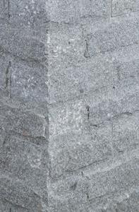 Maus grauer Mauerstein. Schlicht aber Stimmig